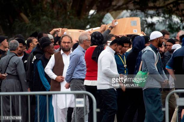 Mourners proceed with a coffin of Sayyad Milne victim of New Zealand's twin mosque massacre for burial after a funeral prayer at the Memorial Park...
