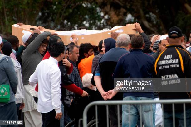 Mourners proceed with a coffin of Tariq Rashid Omar victim of New Zealand's twin mosque massacre for burial after a funeral prayer at the Memorial...