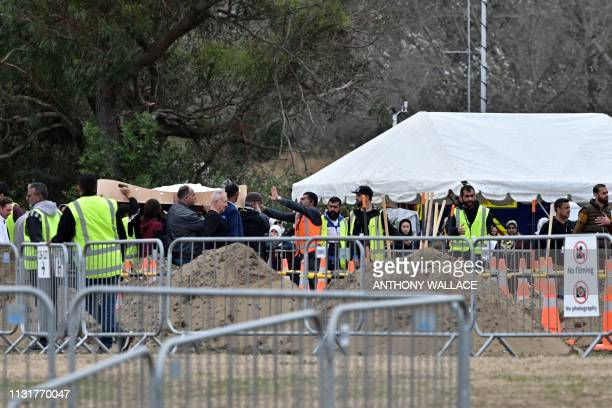Mourners proceed with the carry at the Memorial Park Cemetery in Christchurch on March 21 six days after twin mosque shooting incident that claimed...