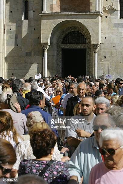 Mourners queue at the entrance of Modena's Duomo where the coffin of Maestro Luciano Pavarotti lies in state on September 07 2007 in Modena Italy...