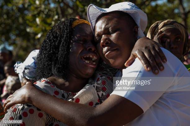 Mourners react as the funeral takes place for Ishmael Kumire on August 4 2018 in Chinamhora Zimbabwe Ishmael was killed during deadly clashes on...