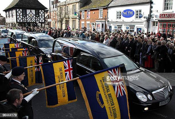 Mourners react as the hearses carrying the bodies of Corporal Liam Riley and Lance Corporal Graham Shaw pass along the High Street on February 5 2009...