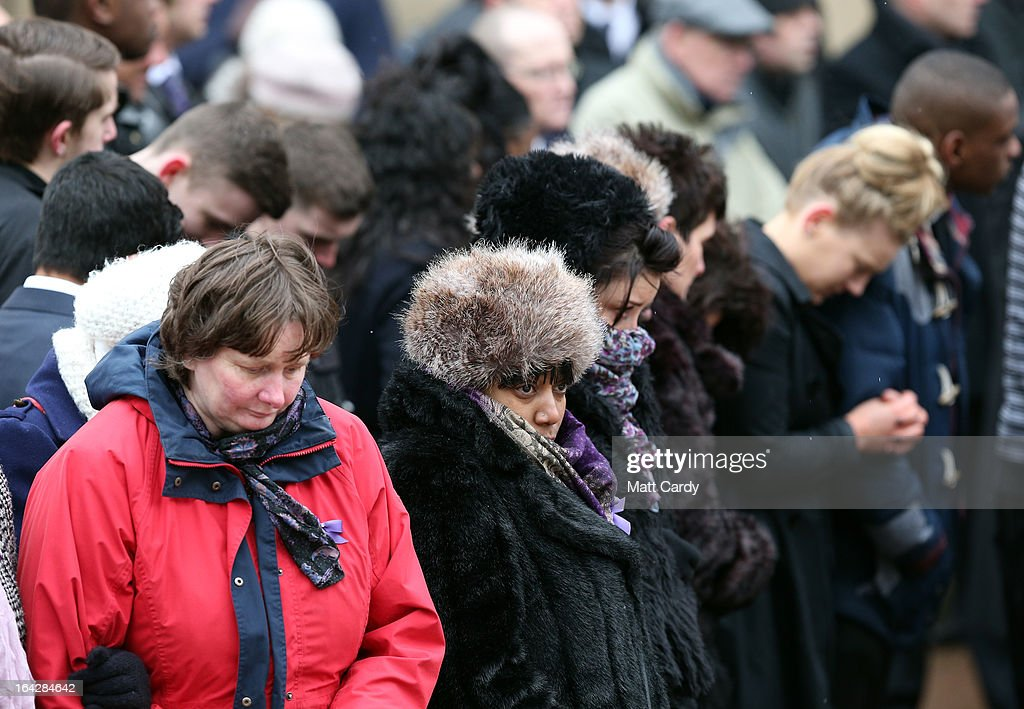Mourners react as they listen to the funeral service of Christina Edkins at St Phillips Cathedral on March 22, 2013 in Birmingham, England. Hundreds of people attended the service for the teenager, who was stabbed to death on a bus in Birmingham. Leasowes High School, in Halesowen, where the 16-year-old was a pupil, was closed today to allow children and staff to join her family at the service.