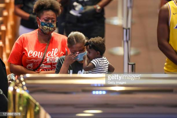 Mourners react as they visit the casket of George Floyd during a public visitation at the Fountain of Praise church June 8 2020 in Houston Texas...