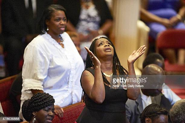 Mourners react at a funeral for Ethel Lance at Royal Missionary Baptist Church on Thursday June 25 2015 in North Charleston SC Lance and eight others...