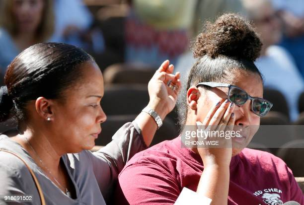 Mourners react during a prayer vigil for the victims of the Marjory Stoneman Douglas High School shooting at Parkridge Church in Coral Springs...