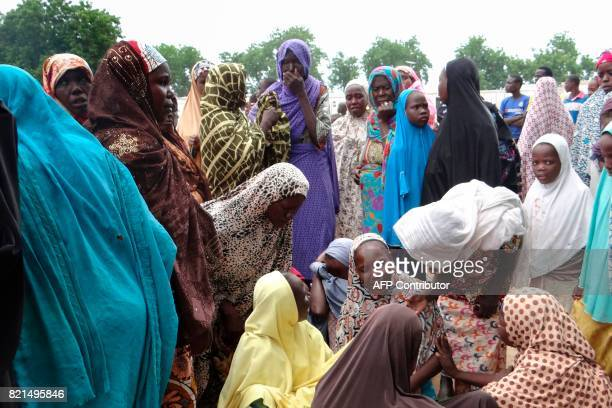 Mourners react on July 24 in the Dalori IDP camp outside Maiduguri after a suicide bomb attack that killed four Four people were killed in suicide...