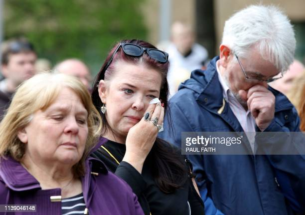 Mourners react outside St Anne's Cathedral in Belfast on April 24 following the funeral service of journalist Lyra McKee who was killed by a...