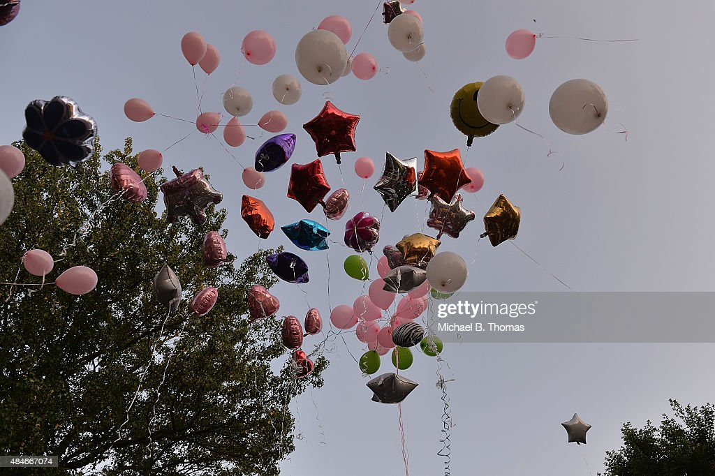Mourners release balloons during a candlelight vigil held in honor of Jamyla Bolden on August 20, 2015 in Ferguson, Missouri. Jamyla Bolden, 9, was allegedly struck by a stray bullet from a drive-by shooting and killed while doing her homework at her home in Ferguson on August 18th.