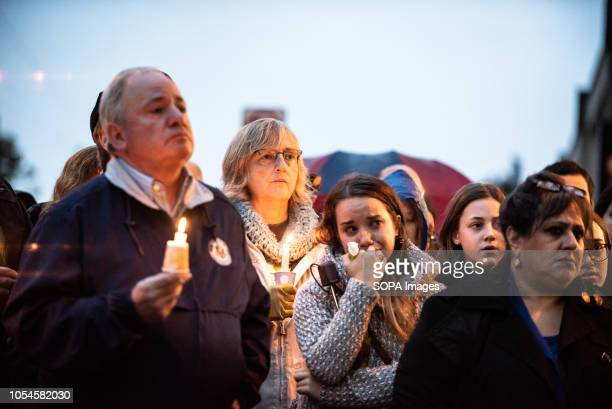 Mourners seen holding candles Aftermath of the mass shooting at the Tree of Life Synagogue in Squirrel Hill Pittsburgh PA While much tragedy struck...