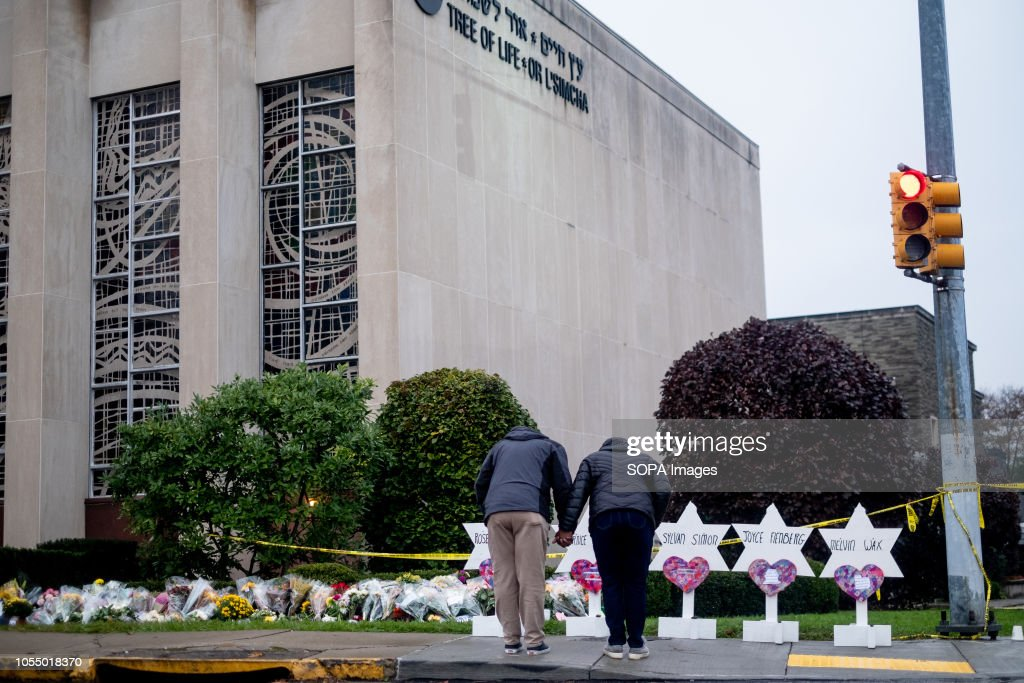 Mourners seen praying in front of the makeshift memorial at... : News Photo