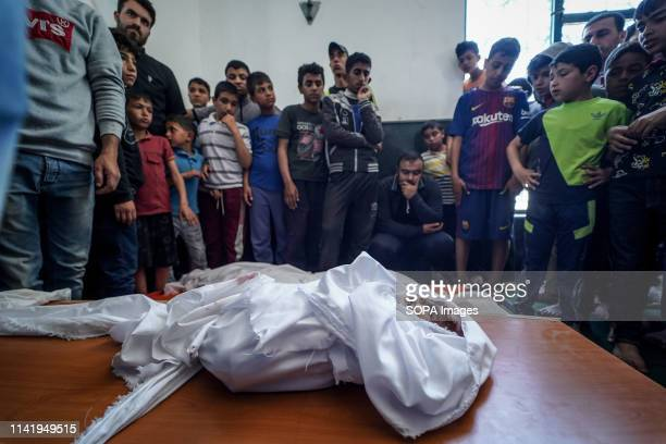 Mourners seen standing next to the body of the deceased during the funeral of Maria alGazali a fourmonthold Palestinian baby who was martyred in an...