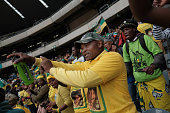 soweto south africa mourners sing dance