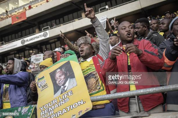 Mourners sing and dance during the official funeral ceremony of late Antiapartheid icon Winnie MadikizelaMandela at the Orlando Stadium in Soweto on...