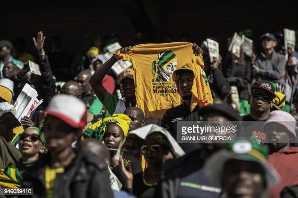 TOPSHOT Mourners sing and dance during the official funeral ceremony of late Antiapartheid icon Winnie MadizikelaMandela at the Orlando Stadium in...