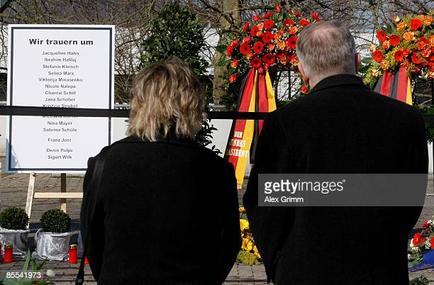 Mourners stand in front of a sign with the names of the victims outside Albertville high school on March 21 2009 in Winnenden near Stuttgart Germany...