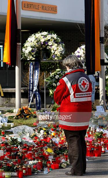 Mourners stand in front of flowers and candles outside Albertville high school on March 21 2009 in Winnenden near Stuttgart Germany 17 year old Tim...