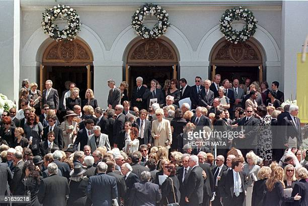 Mourners stand on the steps outside the Good Shepherd Catholic Church in Beverly Hills following funeral services for legendary entertainer Frank...