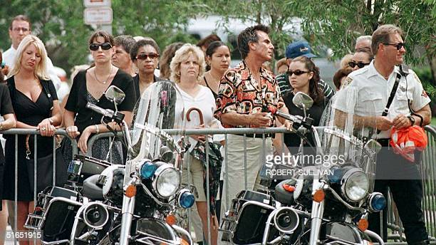Mourners stand outside St Patrick's Catholic Church in Miami Beach FL 18 July during a memorial service for slain Italian designer Gianni Versace...