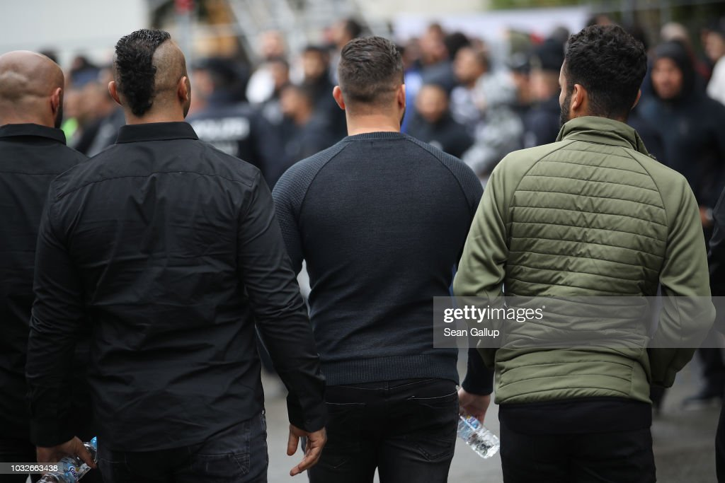 Mourners stand outside the New 12 Apostles cemetery prior to the funeral of Nidal R., an associate of a Berlin Arab clan, on September 13, 2018 in Berlin, Germany. Nidal R., 36, a multiple felon, was gunned down by assailants who managed to flee the scene at a public park last Sunday. Berlin has a growing number of Arab, Kurdish and Turkish clans involved in organized crime.