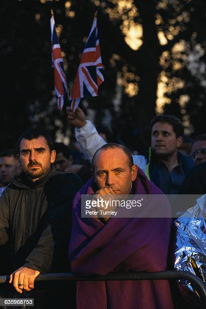 Mourners stand outside Westminster Abbey on the day of Princess Diana's funeral seven days after the tragic automobile accident on August 31 1997 in...