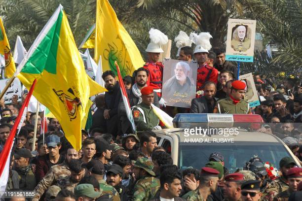 Mourners surround a car carrying the coffin of Iraqi paramilitary chief Abu Mahdi alMuhandis during a funeral procession for him and nine others in...