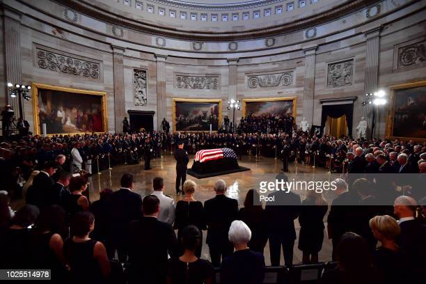 Mourners surround the casket of former Senator John McCain in the Capitol Rotunda where he will lie in state at the at the U.S. Capitol on August 31,...
