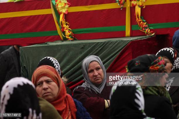 Mourners surround the coffin of a local official, who Fighters from the Syrian Democratic Forces say was assassinated in a Kurdish-held area in the...