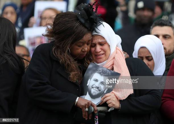 Mourners take a moment as they leave the Grenfell Tower National Memorial service at St Paul's cathedral on December 14 2017 in London England The...