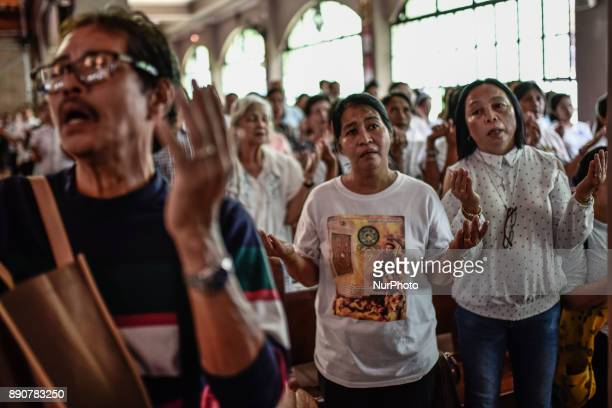 Mourners take part in a mass during the funeral of activist priest Fr Marcelito quotTitoquot Paez in San Jose Nueva Ecija north of Manila Philippines...