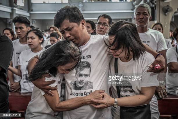 Mourners take part in the funeral of Jhan Cyrell Ignacio a college freshman who was killed by unidentified gunmen in Malabon Metro Manila Philippines...