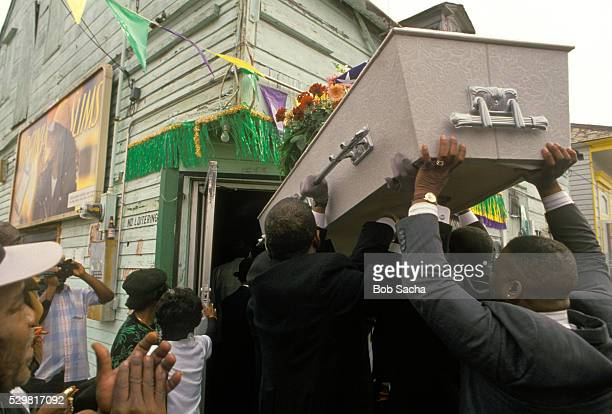 mourners taking casket into bar - pallbearer stock pictures, royalty-free photos & images