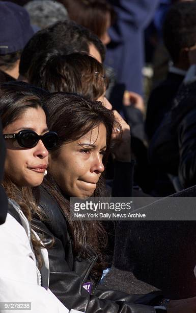 Mourners try to hold back tears during a prayer service for victims of the crash of American Airlines Flight 587 at Jacob Riis Park in the Rockaways...