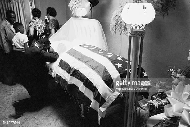 Mourners view the body of civil rights leader Medgar Evers after his assassination