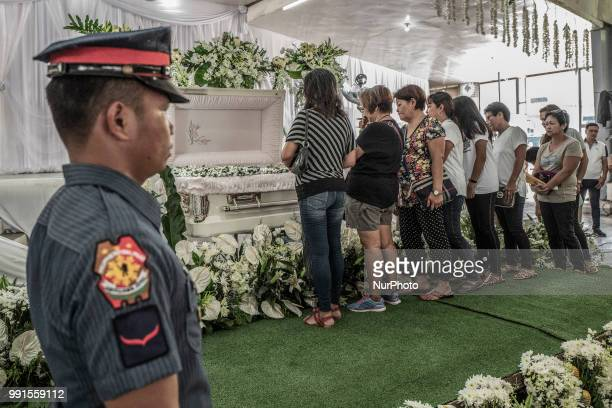 Mourners view the remains of General Tinio Mayor Ferdinand Bote who was assassinated by unidentified gunmen on motorcycles during his funeral wake in...