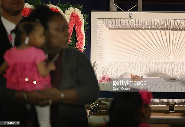 Mourners view the remains of sixmonthold Jonylah Watkins prior to her funeral service at New Beginnings Church on March 19 2013 in Chicago Illinois...