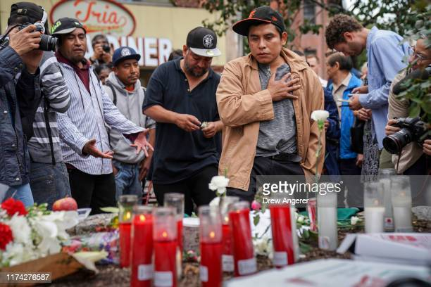Mourners visit a makeshift memorial for four homeless men who were murdered in Chinatown over the weekend October 7 2019 in New York City Randy...