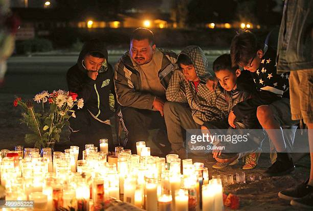 Mourners visit a makeshift memorial near the Inland Regional Center on December 4, 2015 in San Bernardino, California. The FBI has officially labeled...