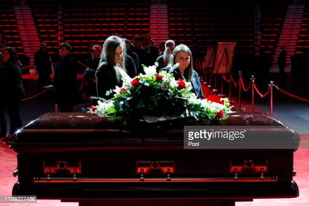 Mourners visit the casket of former Detroit Red Wings player Ted Lindsay at a public viewing Friday March 8 in Detroit Lindsay pioneered the first...