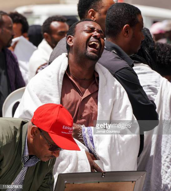 Mourners visit the crash site of Ethiopian Airlines Flight ET302 on March 14 2019 in Ejere Ethiopia All 157 passengers and crew perished after the...