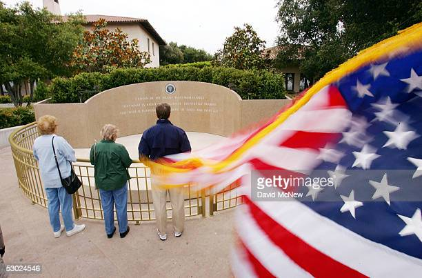 Mourners visit the grave of US President Ronald Reagan on the oneyear anniversary of his death at the Ronald Reagan Presidential Library and Museum...