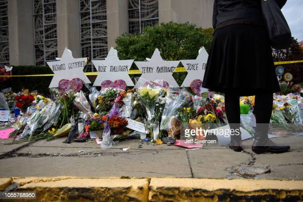 Mourners visit the memorial outside the Tree of Life Synagogue on October 31 2018 in Pittsburgh Pennsylvania Eleven people were killed in a mass...