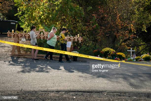 Mourners visit the site of a fatal limousine crash that killed 20 people near the intersection of Route 30 South and Route 30A October 10 2018 in...