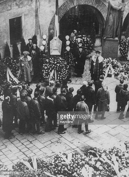 Mourners visiting the coffin of Czech student Jan Palach, following his death by self immolation in protest against the Prague Spring, lying in state...