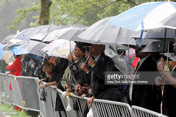 Mourners wait for hours in the pouring rain to attend funeral services for Luther Vandross at the Riverside Church on the upper West Side The RB...
