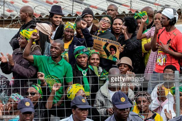 Mourners wait for the arrival of the coffin of Winnie Mandela late antiapartheid icon and exwife of former South African president Nelson Mandela at...