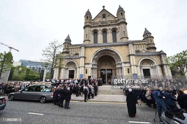 Mourners wait for the coffin of journalist Lyra McKee to be taken out of the church after the funeral at St Anne's Cathedral on April 24 2019 in...