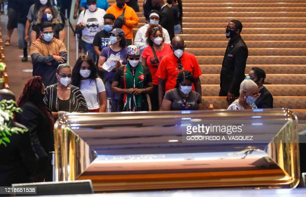 TOPSHOT Mourners wait in line to pass by the casket of George Floyd during a public viewing at the Fountain of Praise church Monday June 8 in Houston