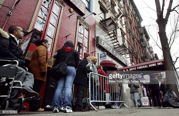 Mourners wait on line outside the Ortiz Funeral Home on First Ave in Manhattan to pay their respects to 7yearold Nixzmary Brown whose battered body...