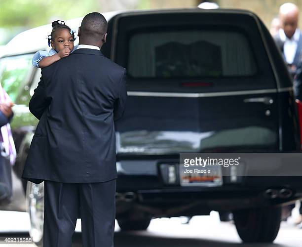 Mourners wait to enter the WORD Ministries Christian Center as the hearse carrying Walter Scott arrives for his funeral after he was fatally shot by...